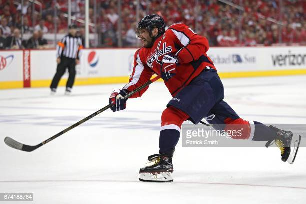 Alex Ovechkin of the Washington Capitals shoots a goal against the Pittsburgh Penguins in the second period in Game One of the Eastern Conference...