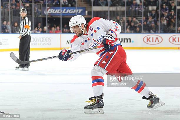 Alex Ovechkin of the Washington Capitals shoots and scores in the second period against the New York Rangers at Madison Square Garden on March 29,...