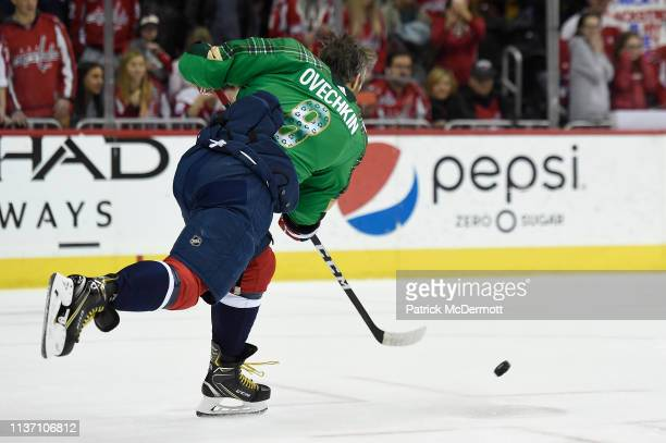 Alex Ovechkin of the Washington Capitals shoots the puck during warmups before playing against the Winnipeg Jets at Capital One Arena on March 10...