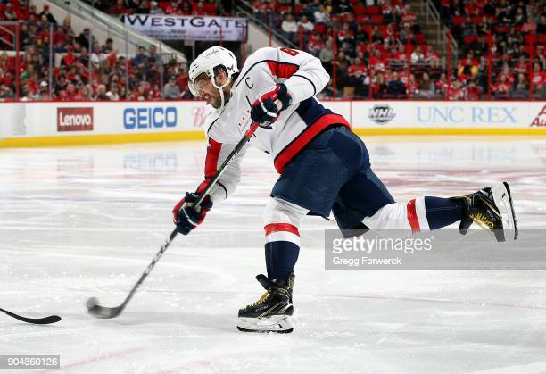 Alex Ovechkin of the Washington Capitals shoots the puck leading to a powerplay goal against the Carolina Hurricanes during an NHL game on January 12...