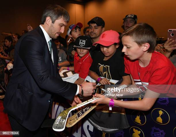 Alex Ovechkin of the Washington Capitals signs autographs for fans as he arrives at the 2018 NHL Awards presented by Hulu at the Hard Rock Hotel...