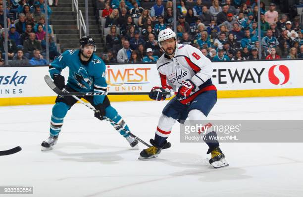 Alex Ovechkin of the Washington Capitals skates against MarcEdouard Vlasic of the San Jose Sharks at SAP Center on March 10 2018 in San Jose...