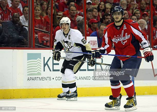 Alex Ovechkin of the Washington Capitals skates against Sidney Crosby of the Pittsburgh Penguins during Game Seven of the Eastern Conference...