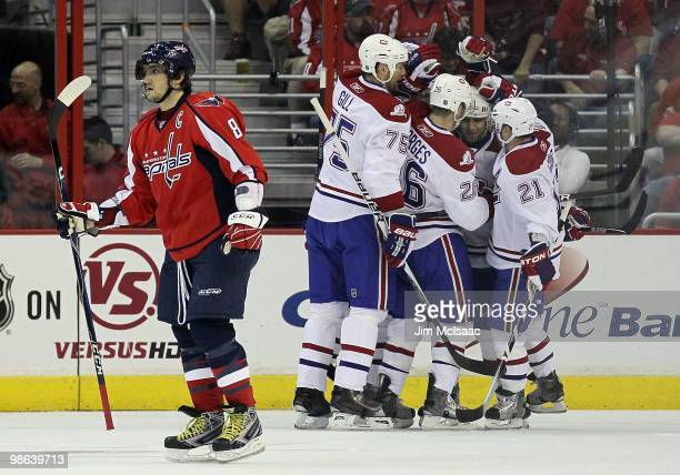 Alex Ovechkin of the Washington Capitals skates away as the Montreal Canadiens celebrate their second goal of the first period scored by Travis Moen...