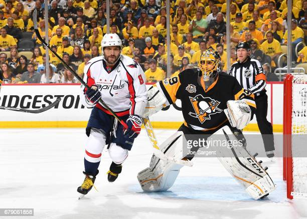 Alex Ovechkin of the Washington Capitals skates in front of Marc-Andre Fleury of the Pittsburgh Penguins in Game Three of the Eastern Conference...