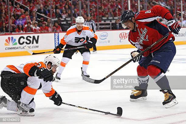 Alex Ovechkin of the Washington Capitals skates in front of Radko Gudas of the Philadelphia Flyers during the second period in Game One of the...