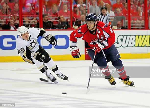 Alex Ovechkin of the Washington Capitals skates the puck past Ruslan Fedotenko of the Pittsburgh Penguins during Game Five of the Eastern Conference...