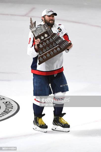 Alex Ovechkin of the Washington Capitals skates with the Conn Smythe Trophy after his team defeated the Vegas Golden Knights 43 in Game Five of the...