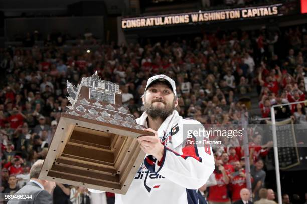 Alex Ovechkin of the Washington Capitals skates with the Conn Smythe Trophy after his team defeats the Vegas Golden Knights 43 in Game Five of the...