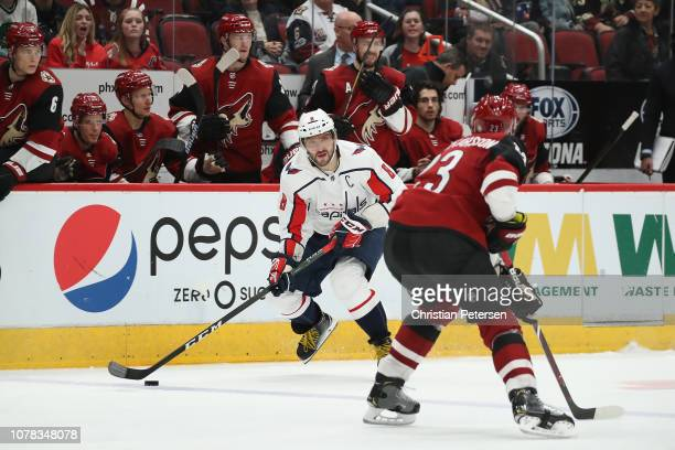 Alex Ovechkin of the Washington Capitals skates with the puck against Oliver EkmanLarsson of the Arizona Coyotes during the third period of the NHL...