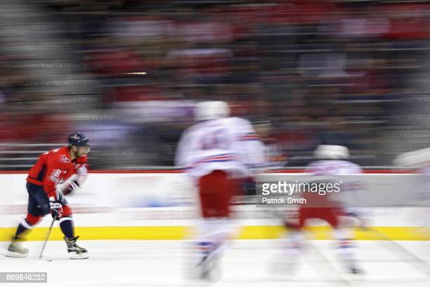 Alex Ovechkin of the Washington Capitals skates with the puck against the New York Rangers during the first period at Capital One Arena on December...