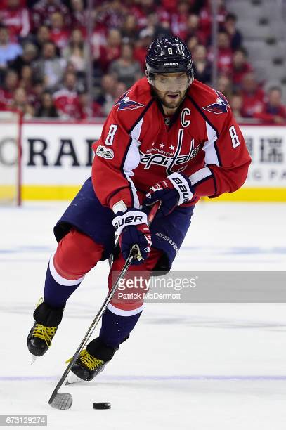 Alex Ovechkin of the Washington Capitals skates with the puck in the first period against the Toronto Maple Leafs in Game One of the Eastern...