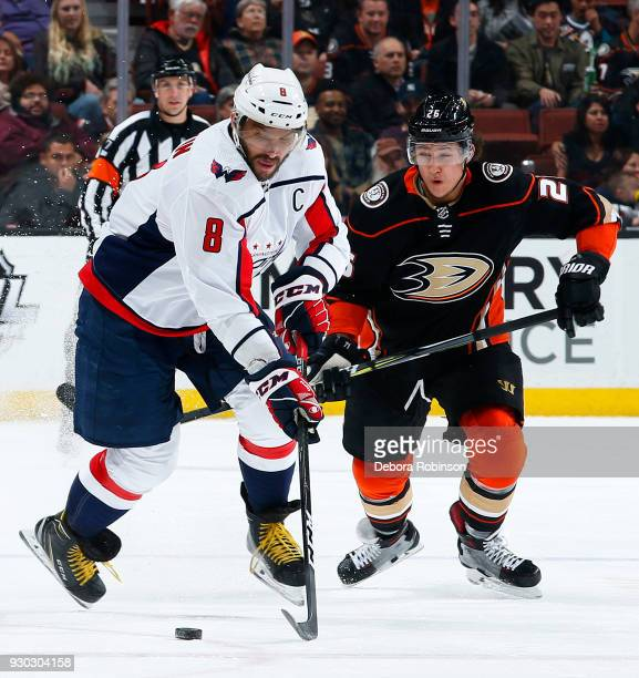Alex Ovechkin of the Washington Capitals skates with the puck with pressure from Brandon Montour of the Anaheim Ducks during the game on March 6 2018...