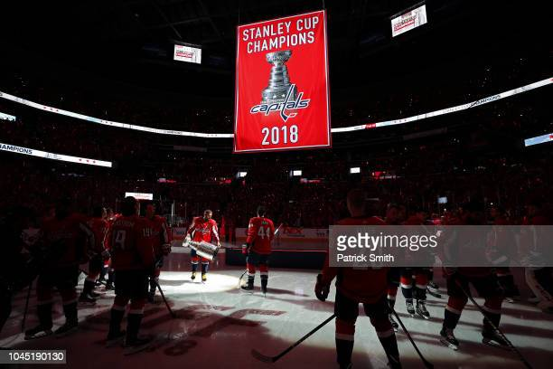 Alex Ovechkin of the Washington Capitals skates with the Stanley Cup prior to watching the 2018 Stanley Cup Championship banner rise to the rafters...