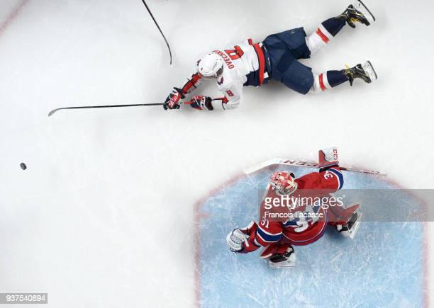 Alex Ovechkin of the Washington Capitals slides for the rebounding puck in front of Carey Price of the Montreal Canadiens in the NHL game at the Bell...