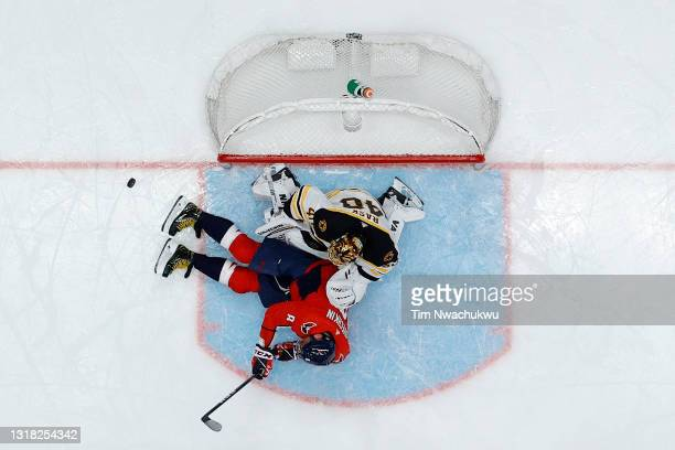 Alex Ovechkin of the Washington Capitals slides into Tuukka Rask of the Boston Bruins during the third period during Game One of the First Round of...