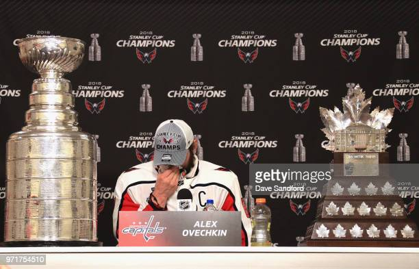 Alex Ovechkin of the Washington Capitals speaks to the media next to the Conn Smythe Trophy and the Stanley Cup after the Capitals defeated the Vegas...