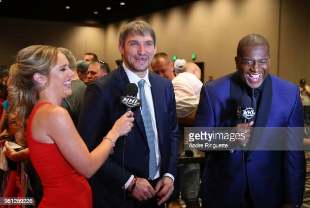 Alex Ovechkin of the Washington Capitals speaks with NHL Network sportscasters Jamie Hersch and Kevin Weekes as Ovechkin arrives at the 2018 NHL...