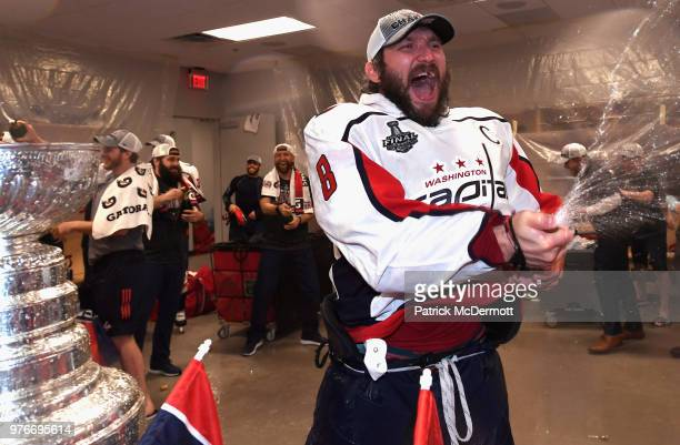 Alex Ovechkin of the Washington Capitals sprays champagne in celebration of winning the Stanley Cup in the locker room after his team defeated the...