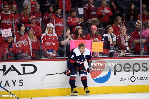Alex Ovechkin of the Washington Capitals stands on the ice before a game against the Dallas Stars at Capital One Arena on March 20 2018 in Washington...