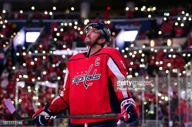 Alex Ovechkin of the Washington Capitals stands on the ice with his teammates and the Detroit Red Wings for a NHLwide moment of silence for Hockey...