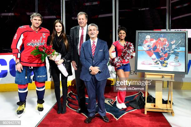 Alex Ovechkin of the Washington Capitals stands on the ice with his wife Nastya Ovechkina Capitals president Dick Patrick and Capitals owner Ted...