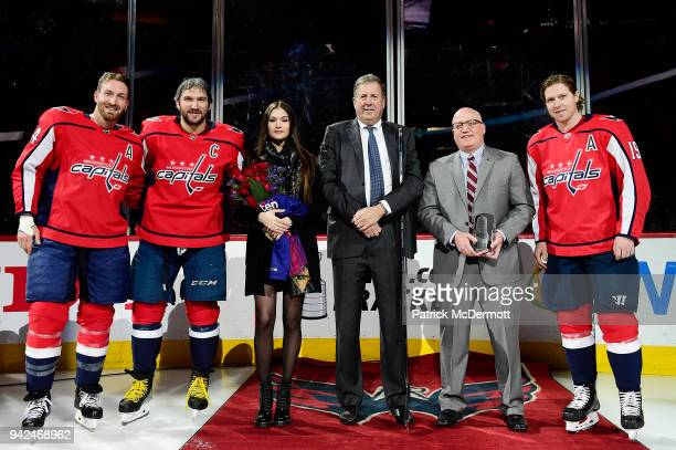 Alex Ovechkin of the Washington Capitals stands with Brooks Orpik his wife Nastya Ovechkina Capitals president Dick Patrick NHL Deputy Commissioner...