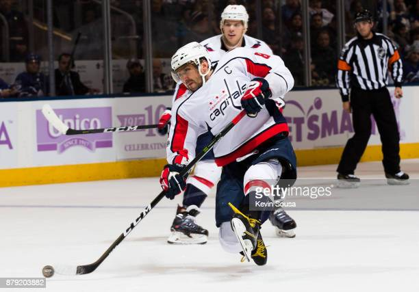 Alex Ovechkin of the Washington Capitals takes a shot that results in his second goal of the game against the Toronto Maple Leafs during the first...