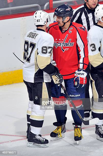 Alex Ovechkin of the Washington Capitals talks with Sidney Crosby of the Pittsburgh Penguins at the Verizon Center on November 20 2013 in Washington...