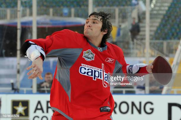 Alex Ovechkin of the Washington Capitals throws a football during practice for the 2011 NHL Bridgestone Winter Classic at Heinz Field on December 31,...