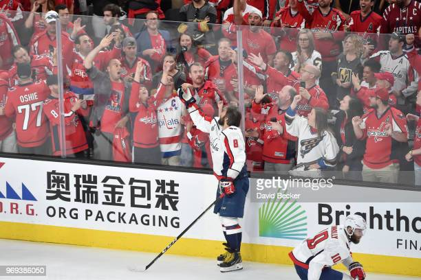 Alex Ovechkin of the Washington Capitals tosses a puck to fans before Game Five of the Stanley Cup Final against the Vegas Golden Knights during the...