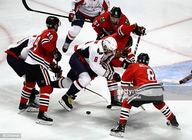 Alex Ovechkin of the Washington Capitals tries to control the puck surronded by Jonathan Toews Brian Campbell Duncan Keith and Nick Schmaltz of the...