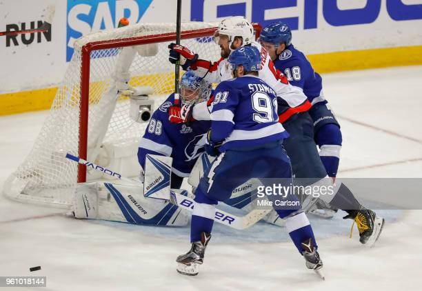 Alex Ovechkin of the Washington Capitals tries to fight through the defense of Steven Stamkos Ondrej Palat and Andrei Vasilevskiy of the Tampa Bay...