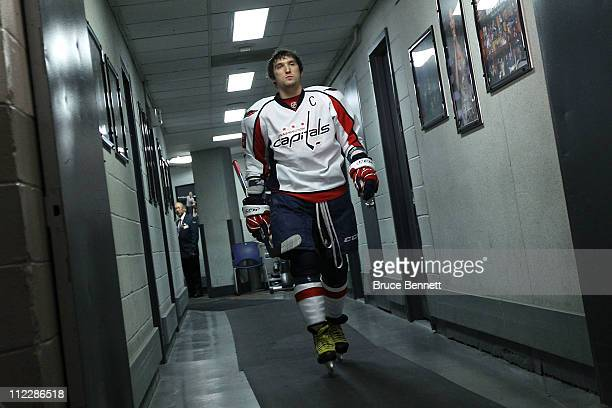 Alex Ovechkin of the Washington Capitals walks from the locker room towards the ice as he gets set to play against the New York Rangers in Game Three...