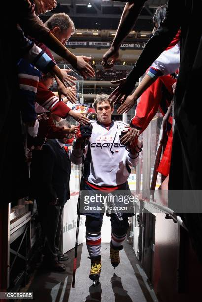 Alex Ovechkin of the Washington Capitals walks off the ice following warm ups to the NHL game against the Phoenix Coyotes at Jobingcom Arena on...