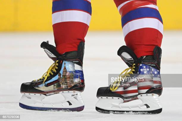 Alex Ovechkin of the Washington Capitals warms up in a custom pair of ice skates before playing the Columbus Blue Jackets at Verizon Center on March...