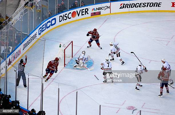 Alex Ovechkin of the Washington Capitals watches Troy Brouwer score past goaltender Corey Crawford of the Chicago Blackhawks to score the game winner...