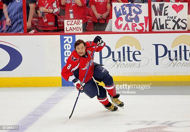 Alex Ovechkin of the Washington Capitals wins the affection of his fans during the pregame warm ups against the Pittsburgh Penguins during Game Five...