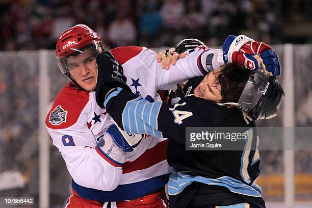 Alex Ovechkin the Washington Capitals fights Chris Kunitz of the Pittsburgh Penguins during the 2011 NHL Bridgestone Winter Classic at Heinz Field on...