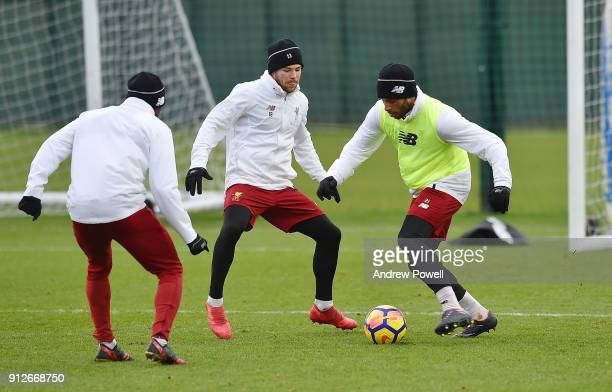 Alex Oxlade Chamberlain and Alberto Moreno of Liverpool during a training session at Melwood Training Ground on January 31 2018 in Liverpool England
