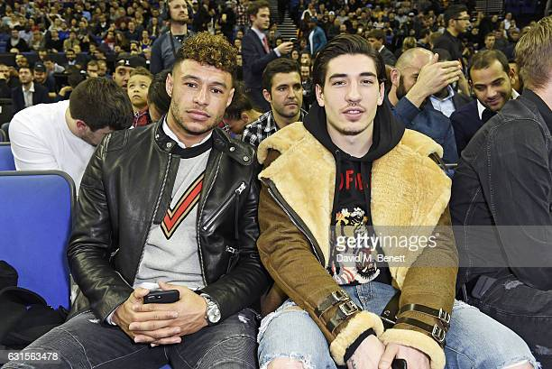 Alex Oxlade Chamberlain and Hector Bellerin sit courtside at the NBA Global Game London 2017 basketball game between the Indiana Pacers and Denver...