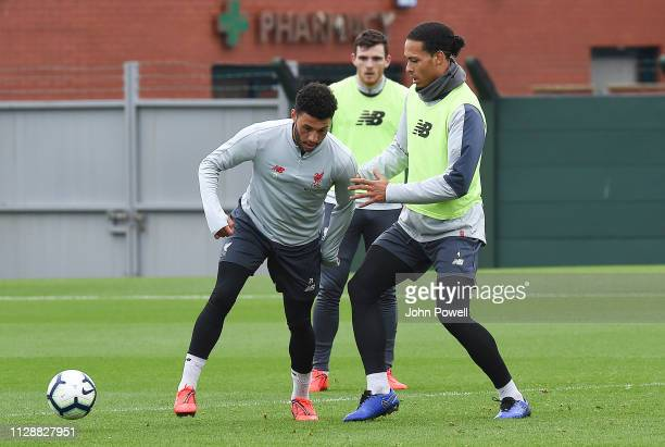 Alex Oxlade Chamberlain battles with Virgil vanDijk of Liverpool during a training session at Melwood Training Ground on March 6 2019 in Liverpool...