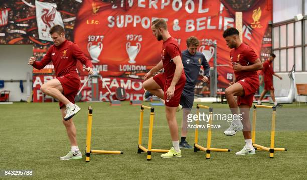 Alex Oxlade Chamberlain Jordan Henderson and James Milner of Liverpool at Melwood Training Ground on September 6 2017 in Liverpool England