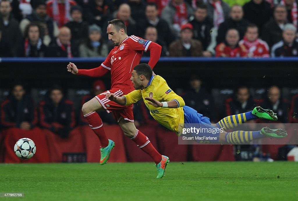 Alex Oxlade Chamberlain of Arsenal is fouled by Franck Ribery of Bayern Munich during the UEFA Champions League Round of 16 match between FC Bayern Muenchen and Arsenal at Allianz Arena on March 11, 2014 in Munich, Bavaria.