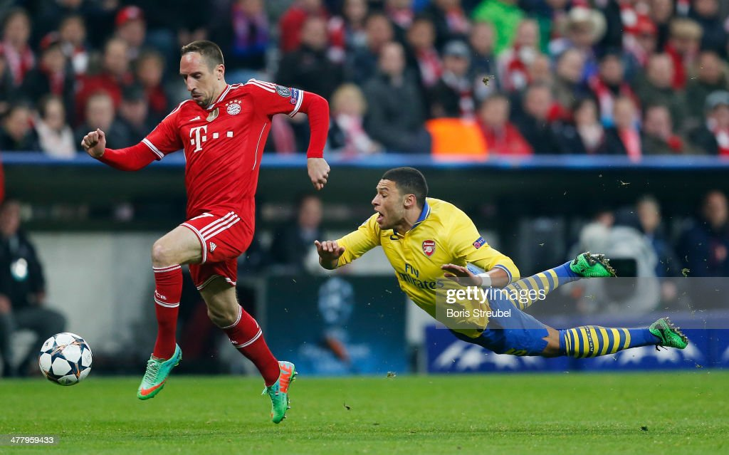 Alex Oxlade Chamberlain (R) of Arsenal is fouled by Franck Ribery of Muenchen during the UEFA Champions League Round of 16 second leg match between FC Bayern Muenchen and Arsenal FC at Allianz Arena on March 11, 2014 in Munich, Germany.