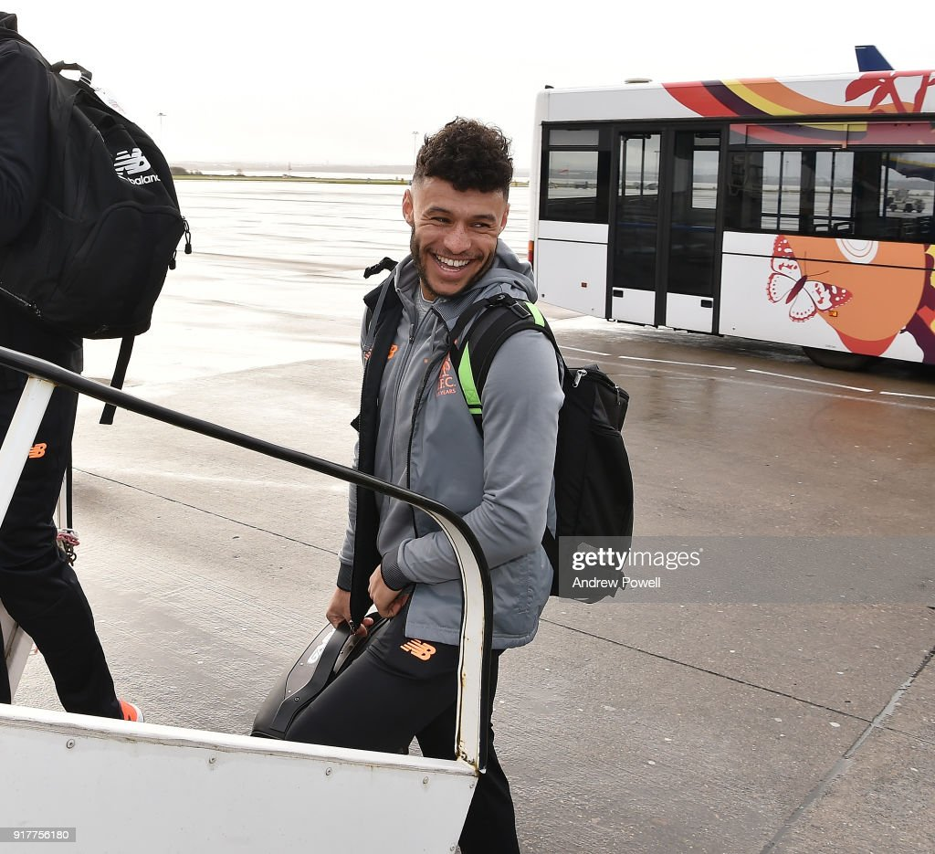 Alex Oxlade Chamberlain of Liverpool board the plane for their trip to Porto at Liverpool John Lennon Airport on February 13, 2018 in Liverpool, England.
