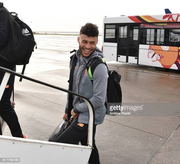 Alex Oxlade Chamberlain of Liverpool board the plane for their trip to Porto at Liverpool John Lennon Airport on February 13 2018 in Liverpool England