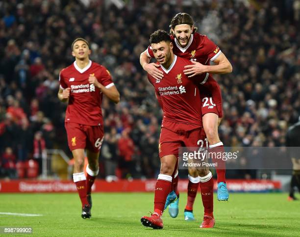 Alex Oxlade Chamberlain of Liverpool celebrates with tearmmates after scoring during the Premier League match between Liverpool and Swansea City at...
