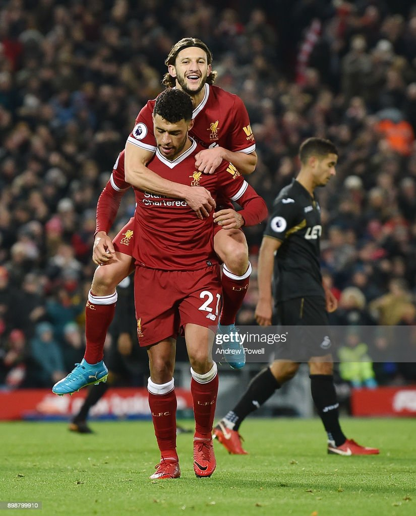 Alex Oxlade -Chamberlain of Liverpool celebrates with tearm-mates after scoring during the Premier League match between Liverpool and Swansea City at Anfield on December 26, 2017 in Liverpool, England.