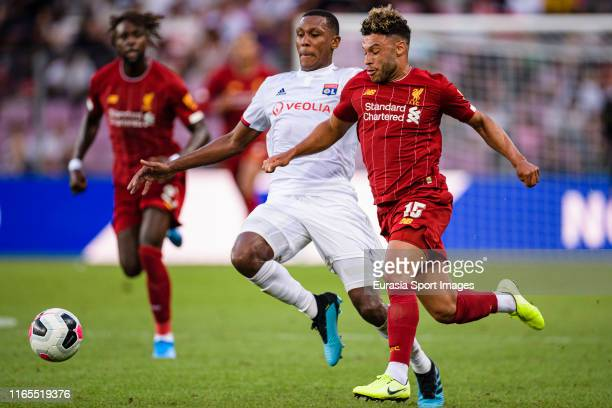 Alex Oxlade Chamberlain of Liverpool in action against Marcelo Guedes of Olympique Lyon during the PreSeason Friendly match between Liverpool FC and...